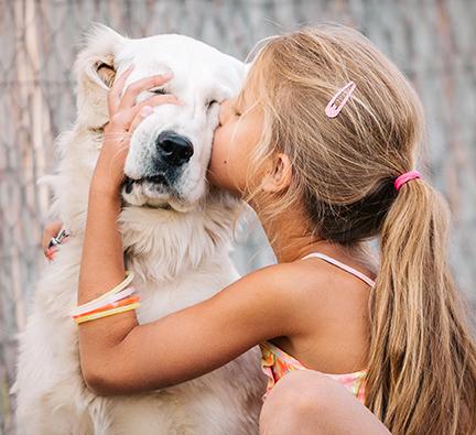 girl kissing white golden